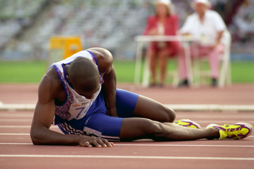 Derek Redmond (GBR) in agony after suffering injury during the Men's 400m race during the 1992 Barcelona Olympics.