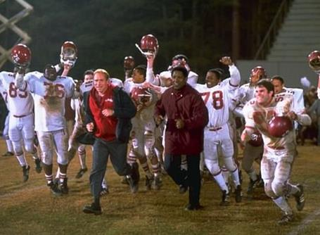 Will Patton, Denzel Washington and cast in Remember the Titans (2000, directed by Boaz Yakin). (photo courtesy of IMDb.com)